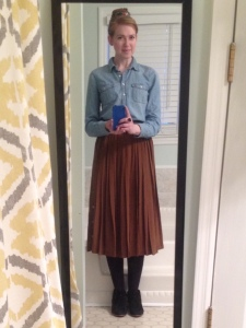 Chambray shirt with pleated silk skirt, black tights, and black suede ankle boots
